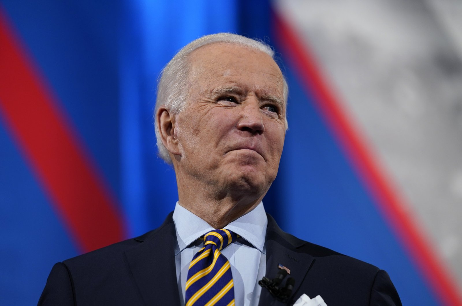 President Joe Biden stands on stage during a break in a televised town hall event at Pabst Theater, in Milwaukee, Wisconsin, U.S., Feb. 16, 2021. (AP Photo)