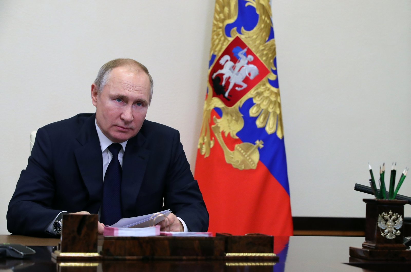 Russian President Vladimir Putin attends a meeting with leaders of the state Duma, the lower house of the Russian parliament factions via videoconference at the Novo-Ogaryovo outside Moscow, Russia, Feb. 17, 2021. (AP Photo)
