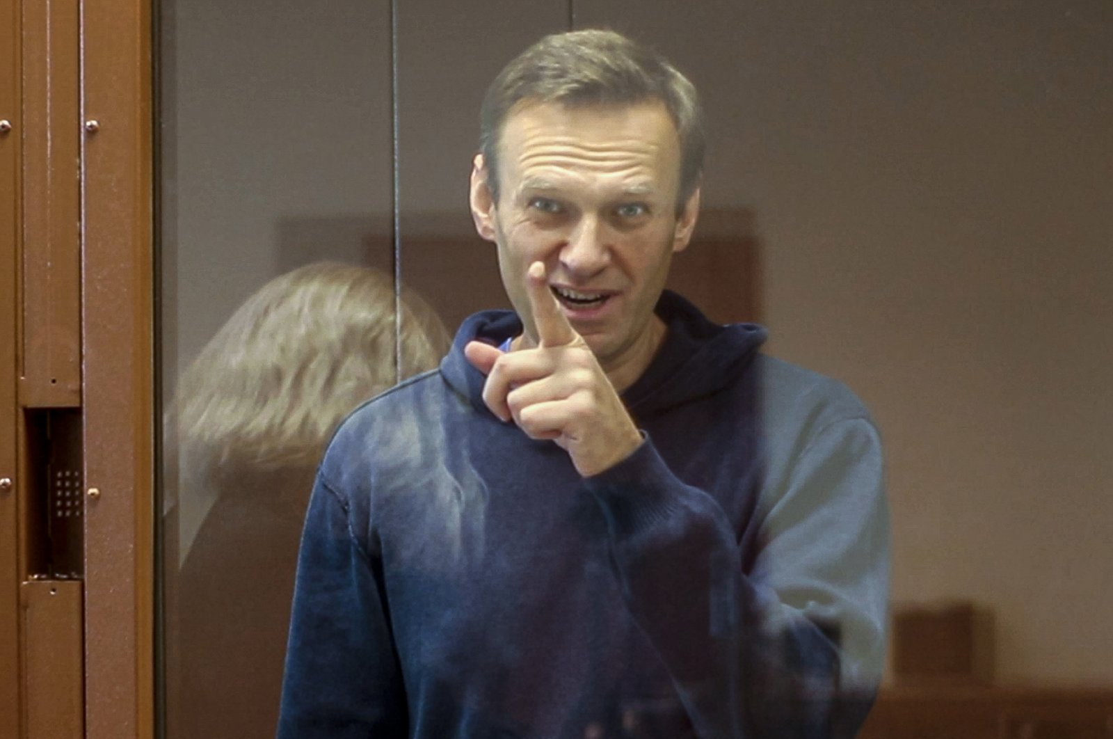 Russian opposition leader Alexei Navalny gestures during a hearing on his charges for defamation in the Babuskinsky District Court in Moscow, Russia, Feb. 16, 2021. (AP Photo)