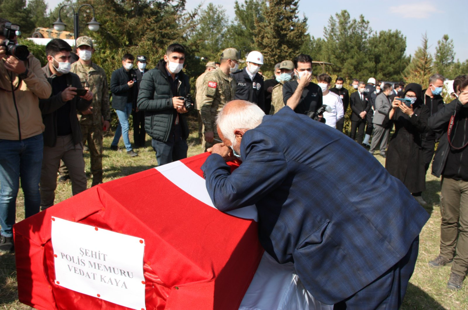 Şeyhmus Kaya, the father of slain police officer Vedat Kaya, bids farewell to the martyr during a funeral ceremony organized in his hometown southeastern Mardin province on Feb. 15, 2021 (AA Photo)