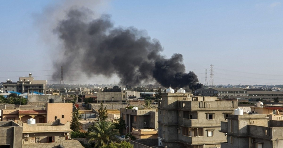 This picture shows smoke plumes rising in Tajoura, south of the Libyan capital Tripoli, following a reported airstrike by forces loyal to retired Gen. Khalifa Haftar, June 29, 2019. (AFP File Photo)