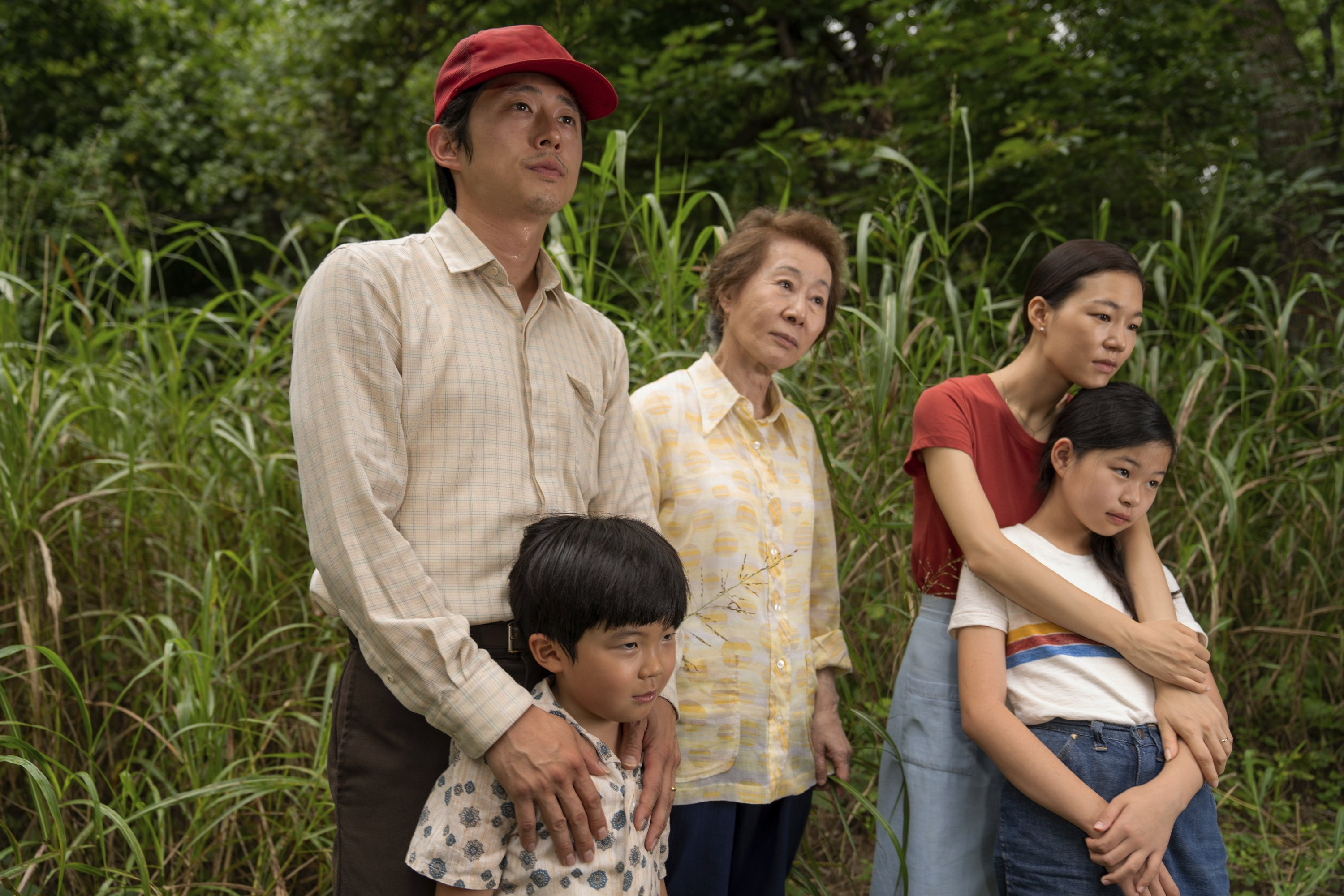 """A still image from the film """"Minari"""" shows from left, Steven Yeun, Alan S. Kim, Yuh-Jung Youn, Yeri Han, and Noel Cho. (AP)"""