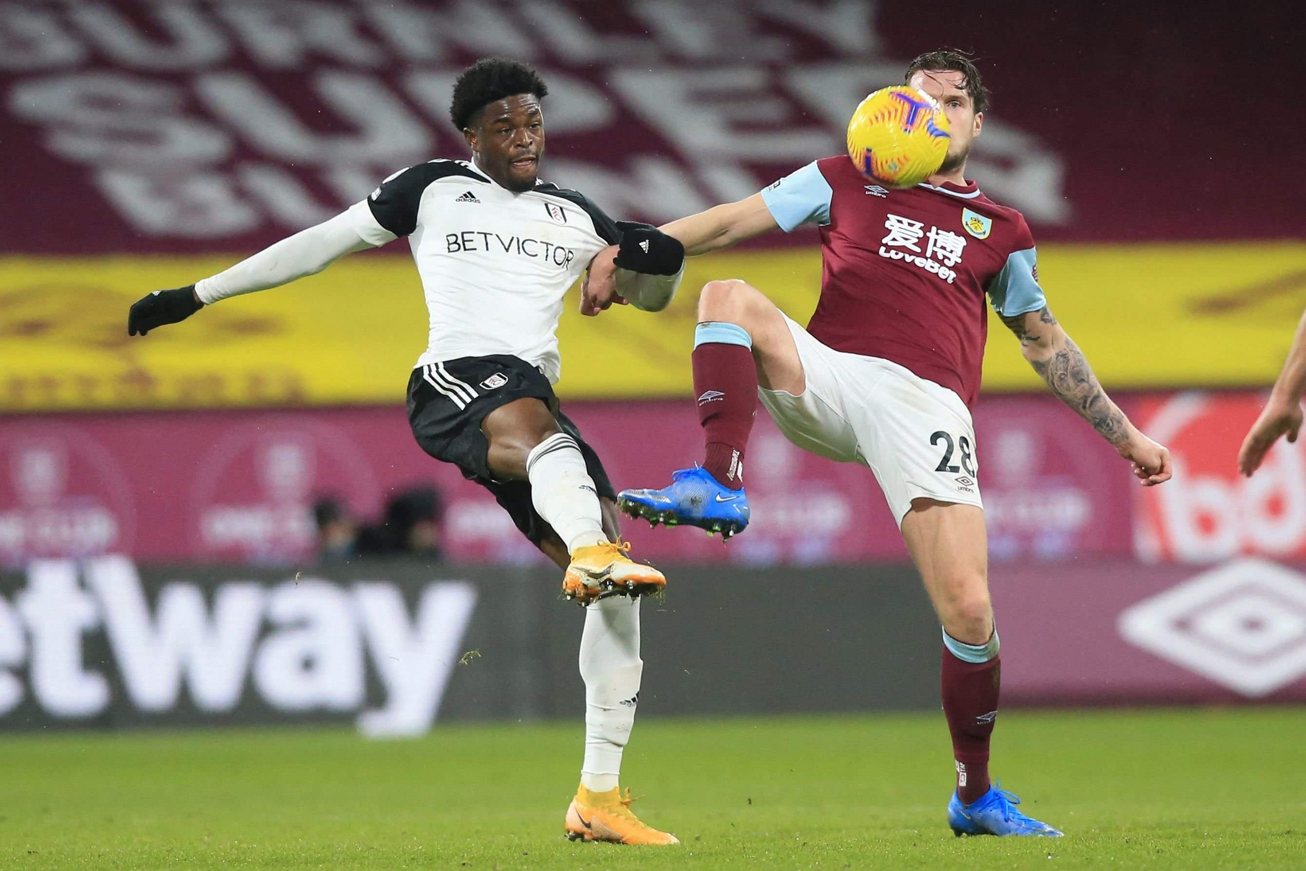 Fulham's Nigerian striker Josh Maja (L) vies with Burnley's Irish defender Kevin Long during their English Premier League match at Turf Moor in Burnley, U.K., Feb. 17, 2021. (AFP Photo)