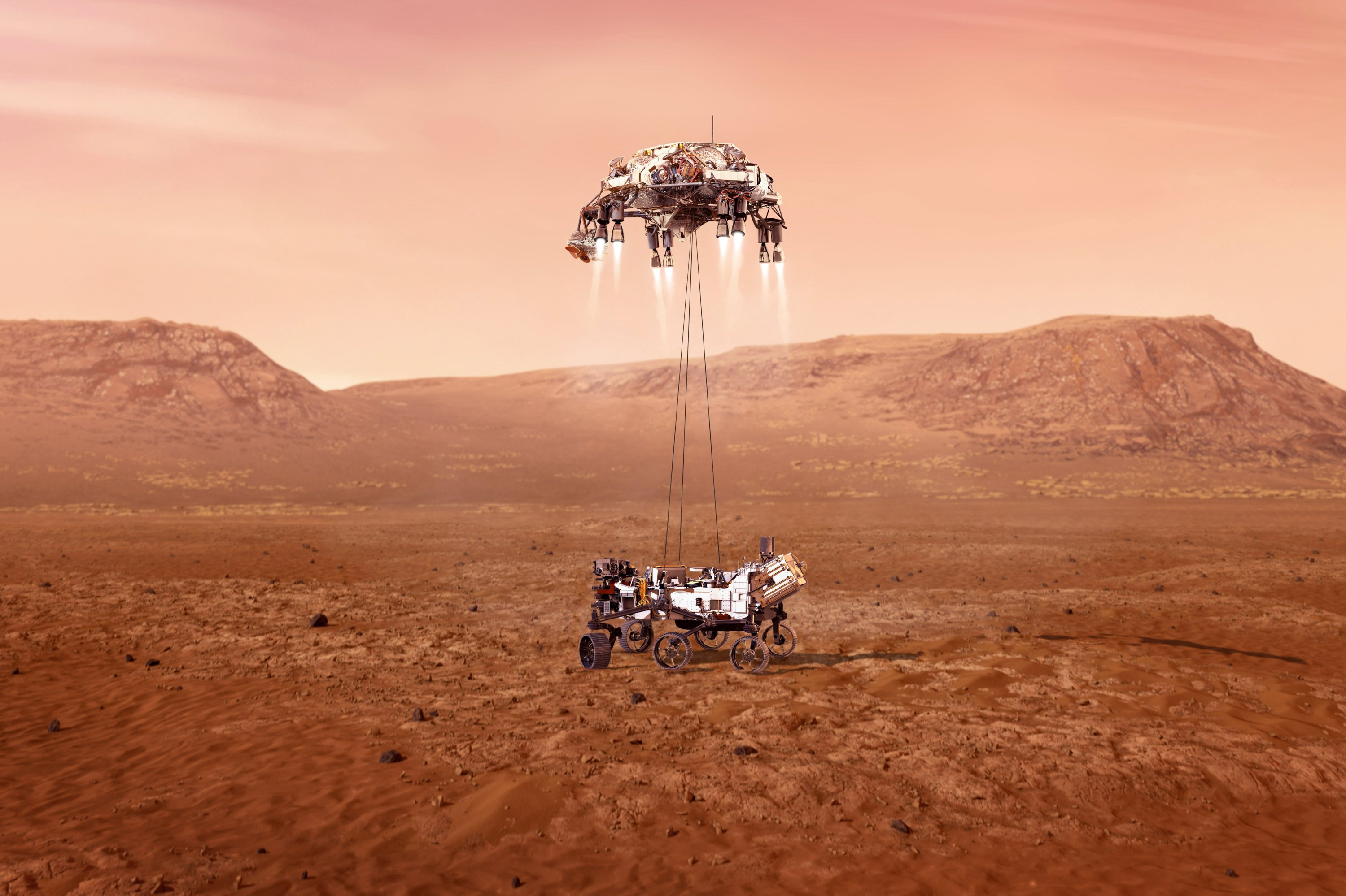 This illustration provided by NASA shows the Perseverance rover, bottom, landing on Mars. Hundreds of critical events must execute perfectly and exactly on time for the rover to land safely on Feb. 18, 2021. (NASA/JPL-Caltech via AP)