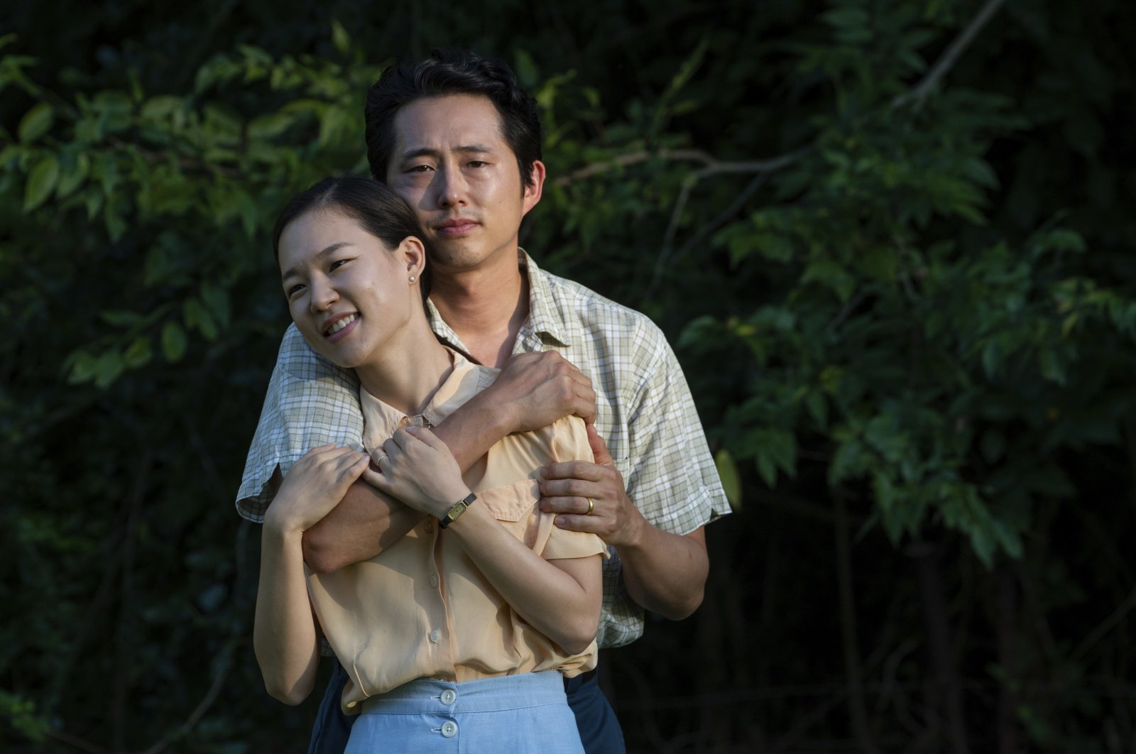 """A still image from the film """"Minari"""" shows Yeri Han, foreground, and Steven Yeun. (AP)"""