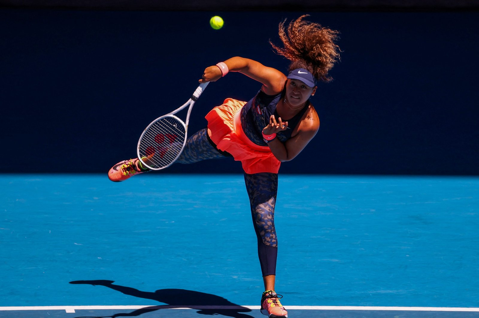 Japan's Naomi Osaka serves against U.S.' Serena Williams during their Australian Open women's singles semifinal in Melbourne, Australia, Feb. 18, 2021. (AFP Photo)