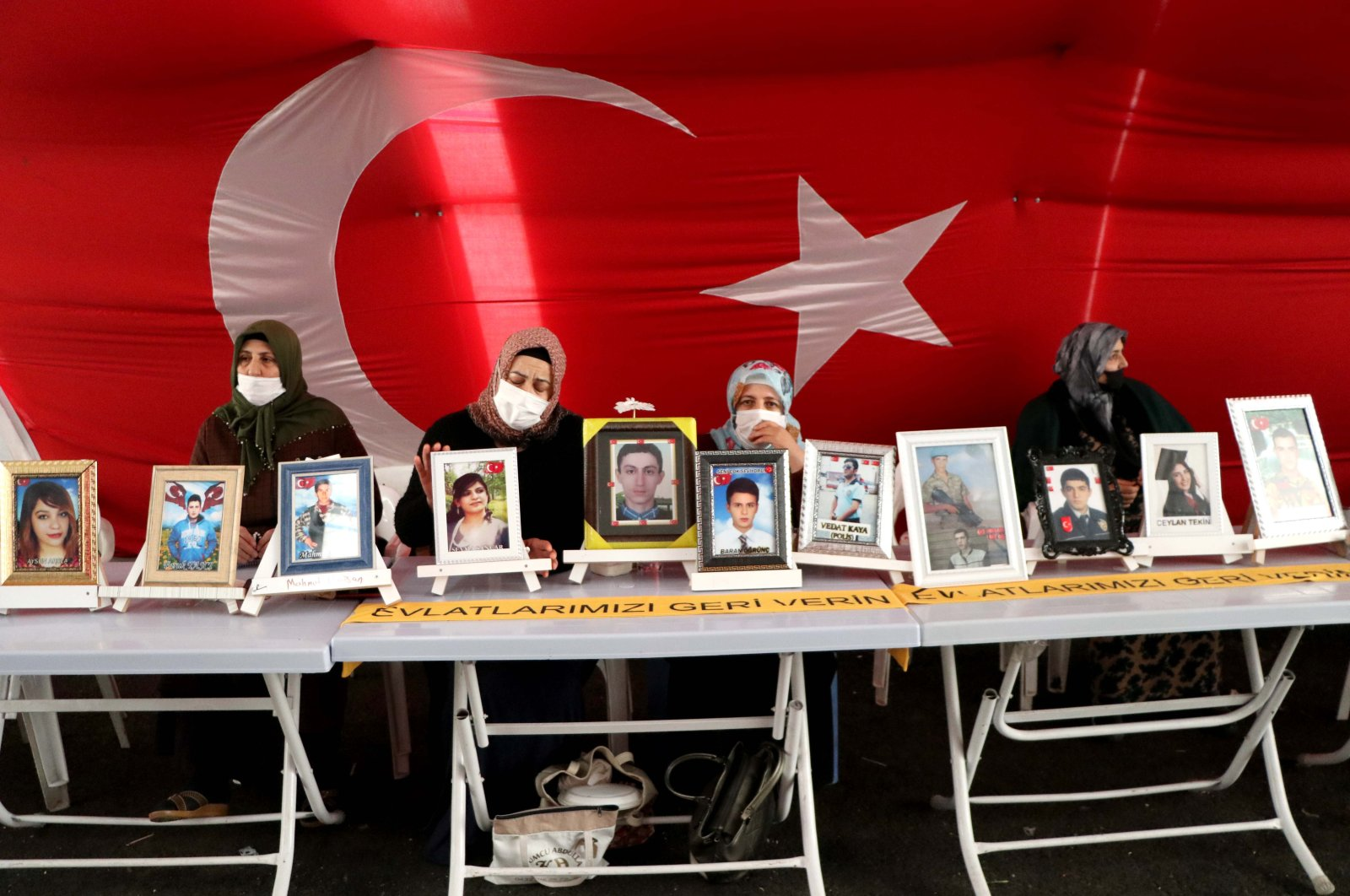 Mothers continue their sit-in protest in a tent displaying photos of their children abducted by the PKK terrorist group, set up outside the pro-PKK Peoples' Democratic Party (HDP) headquarters in Diyarbakır province, southeastern Turkey, Feb. 2, 2021. (AA Photo)