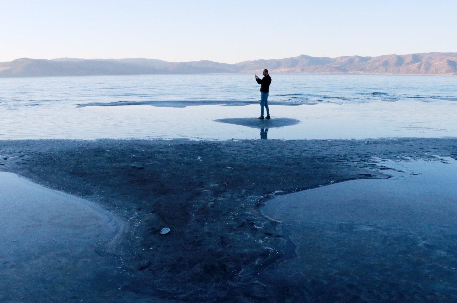 A man stands on an islet at Lake Salda, in Burdur, southwestern Turkey, Feb. 18, 2021. (DHA Photo)