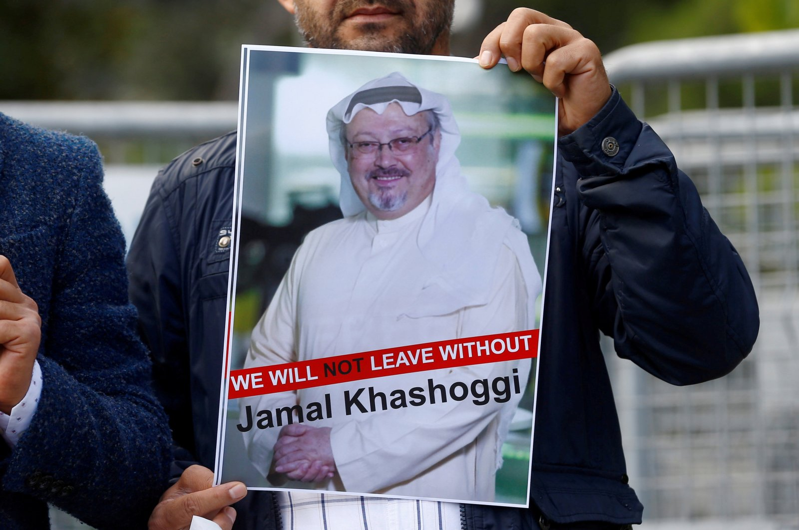 A demonstrator holds a picture of Saudi journalist Jamal Khashoggi during a protest in front of Saudi Arabia's Consulate in Istanbul, Turkey, Oct. 5, 2018. (REUTERS Photo)
