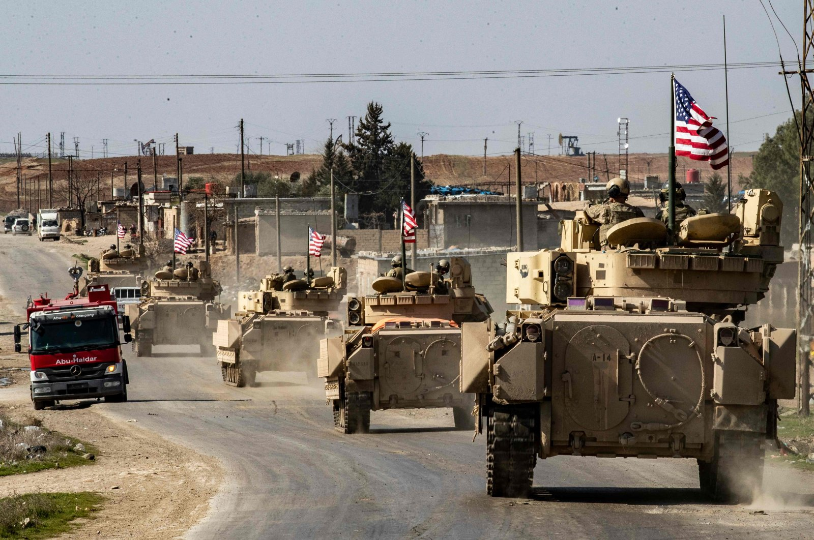 U.S. Bradley Fighting Vehicles (BFV) patrol in the Suwaydiyah oil fields in Hassakeh province, northeastern Syria, Feb. 13, 2021. (AFP Photo)