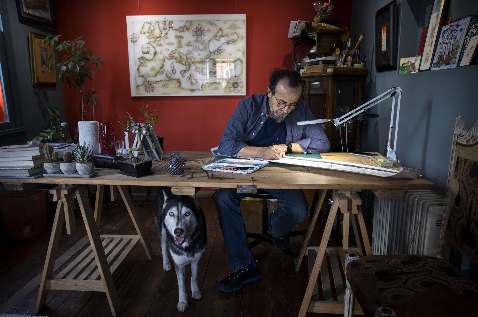 Miniature artist Taner Alakuş works at his workshop in Istanbul, Turkey, Feb. 16, 2021. (AA PHOTO)