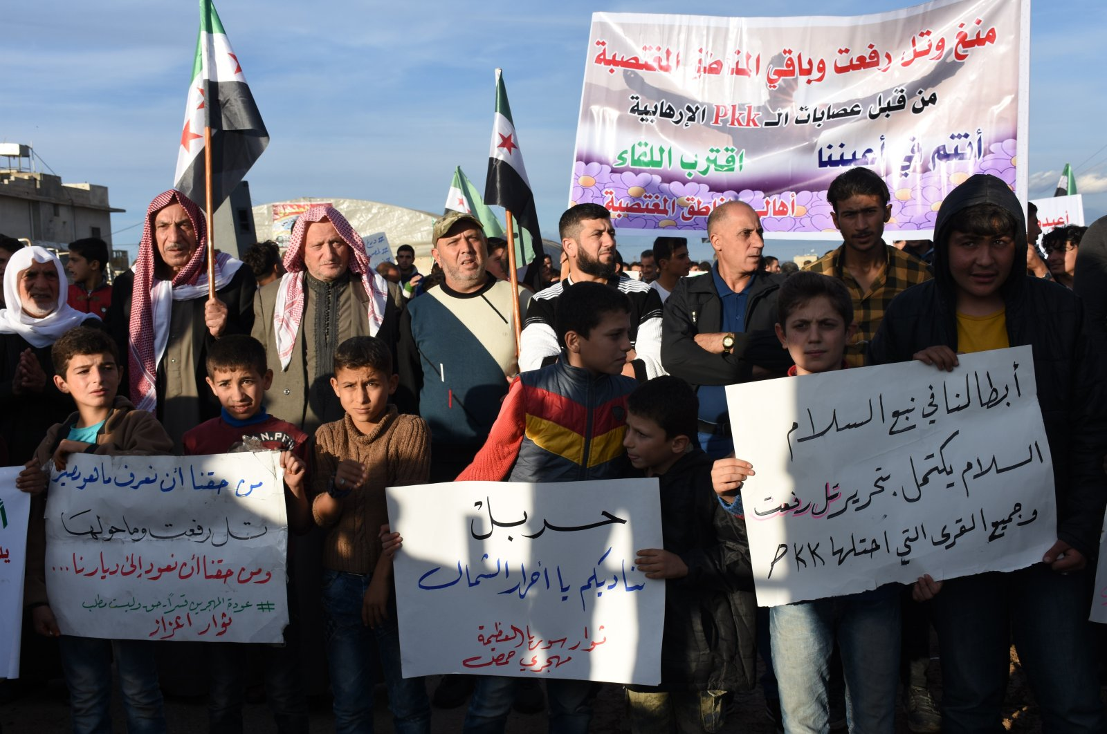 A group of civilians, who were displaced by the YPG, stages a protest against the terror group in Azaz, Syria, Nov. 4, 2019. (AA Photo)