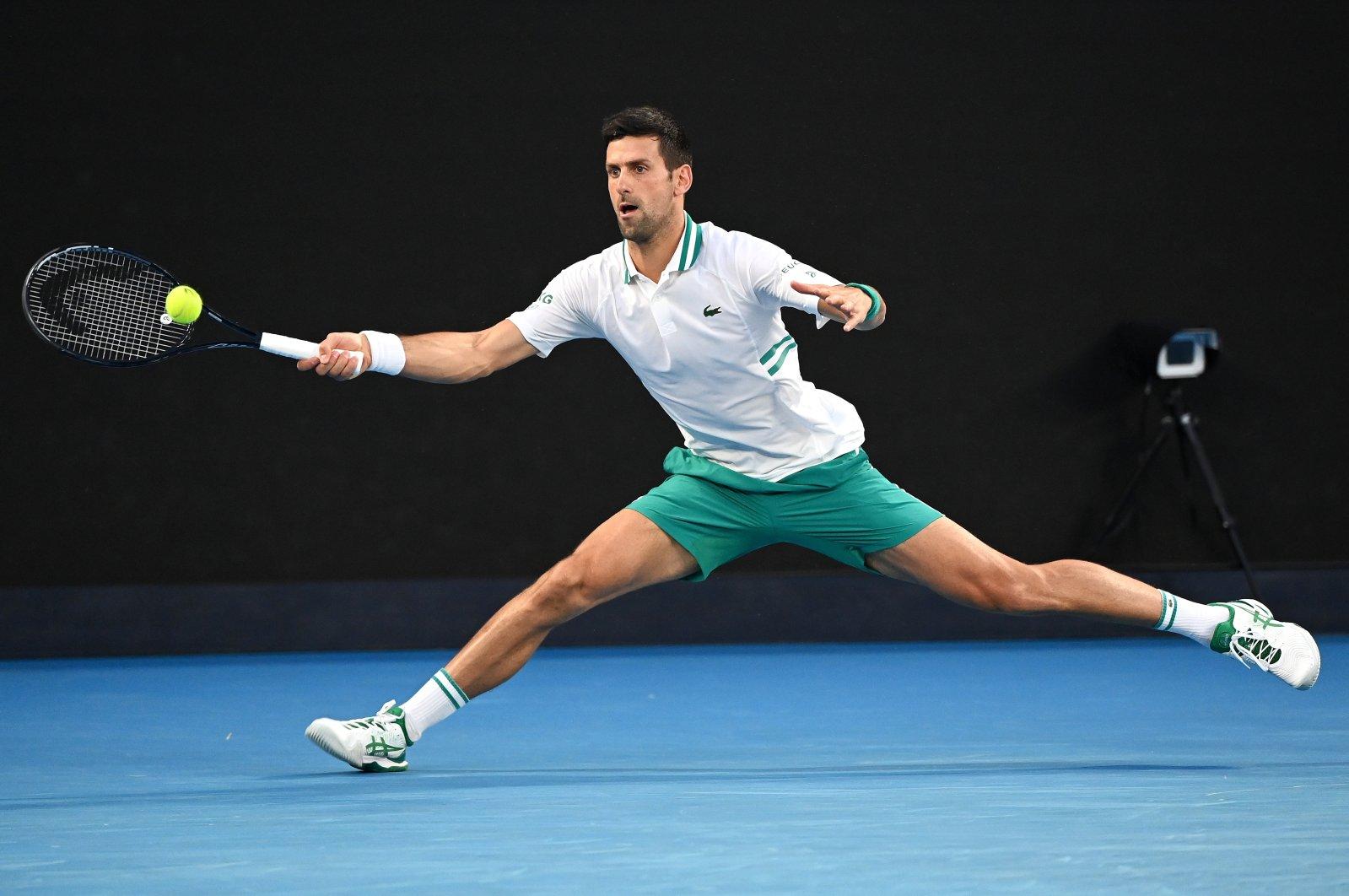 Serbia's Novak Djokovic in action against Russia's Aslan Karatsev in the Australian Open men's singles semifinal at Melbourne Park, Melbourne, Feb. 18, 2021. (EPA Photo)