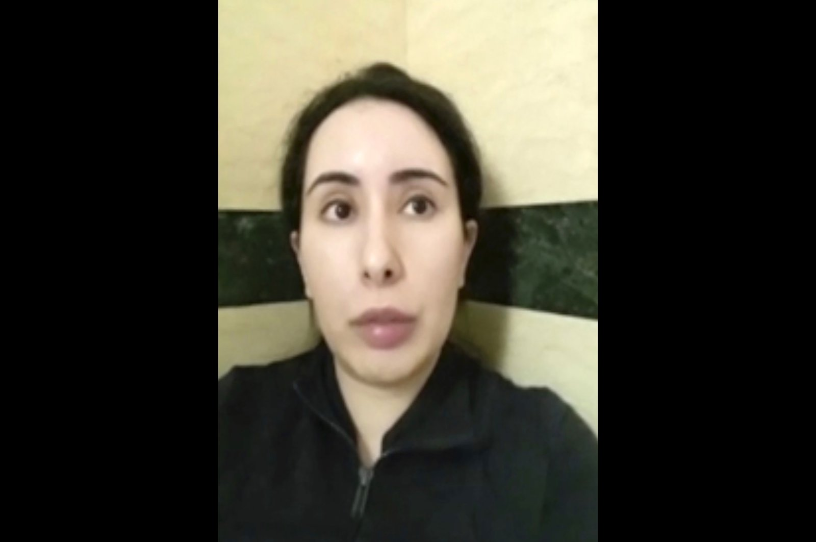 Sheikha Latifa bin Mohammed Al Maktoum speaks into a mobile phone camera in this undated image taken from a video recorded at an unknown location, Feb. 17, 2021. (AP Photo)