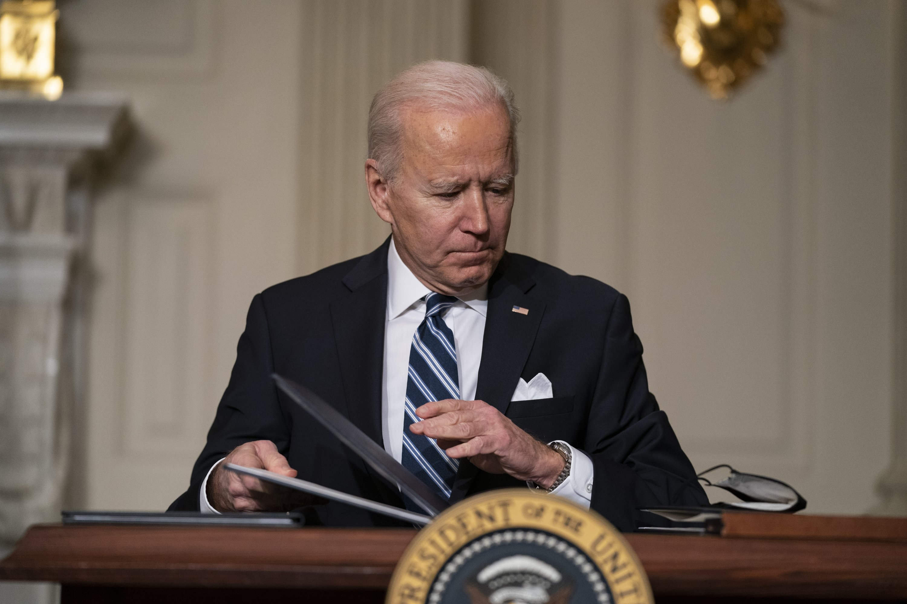 President Joe Biden signs a series of executive orders on climate change, in the State Dining Room of the White House in Washington, U.S., Jan. 27, 2021. (AP Photo)