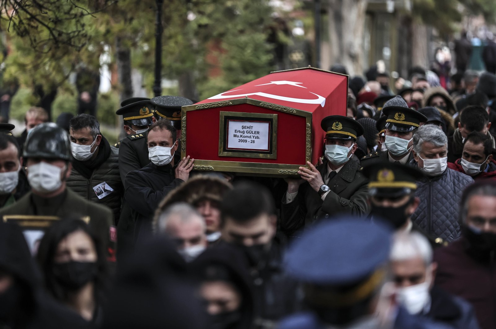 One of three coffins is carried during the funeral prayers for three Turkish soldiers who were killed in action against the PKK terrorist group, Ankara, Turkey, Feb. 12, 2021. (AA Photo)