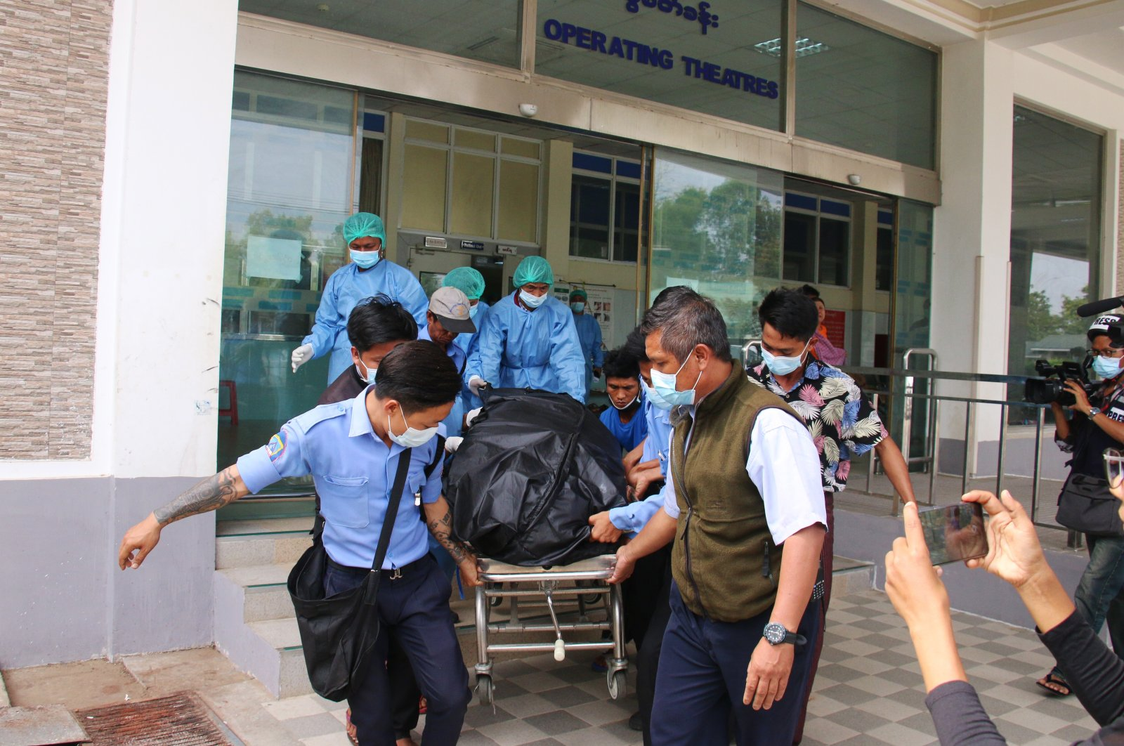 Hospital staff carry the body of Mya Thwe Thwe Khaing, a young woman shot in the head in an anti-coup protest, in Naypyitaw, Myanmar, Feb. 19, 2021. (EPA-EFE Photo)