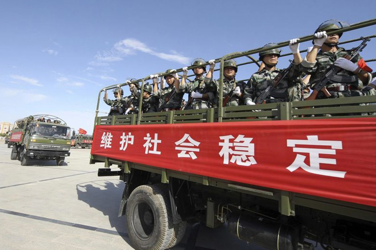Armed members from a Chinese militia take part in a joint exercise in Hami, Uighur Autonomous Region, July 2, 2013. (Reuters Photo)