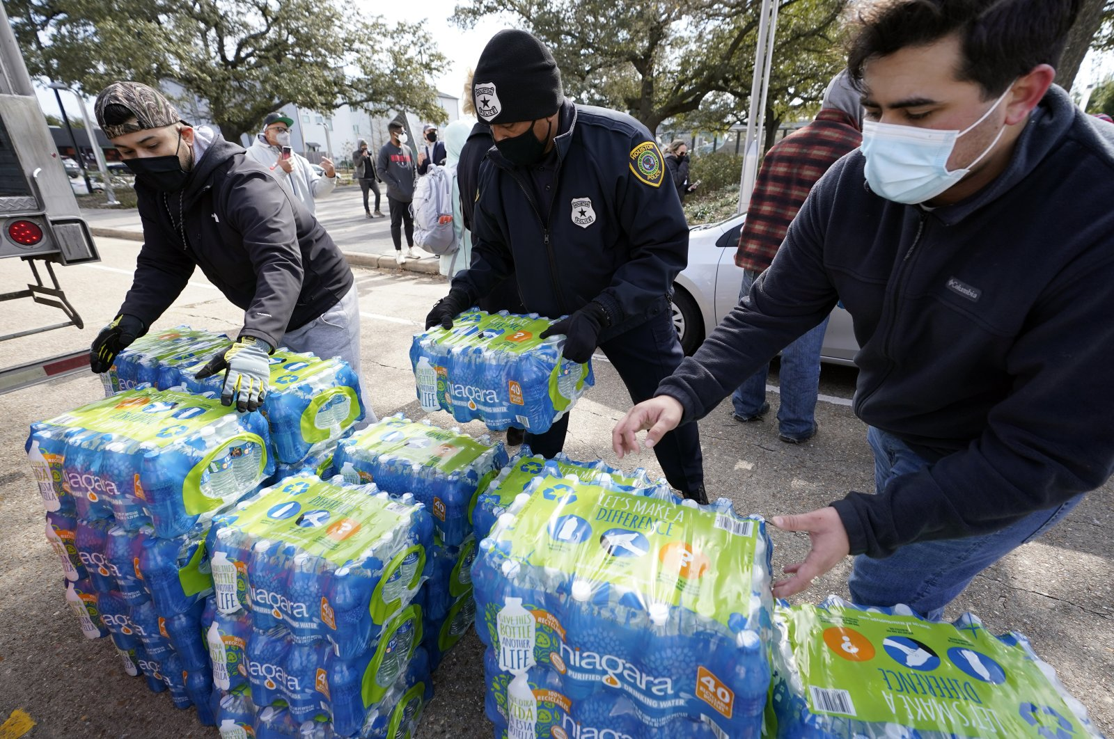 Donated water is distributed to residents, in Houston, Texas, U.S. Feb. 18, 2021. (AP Photo)