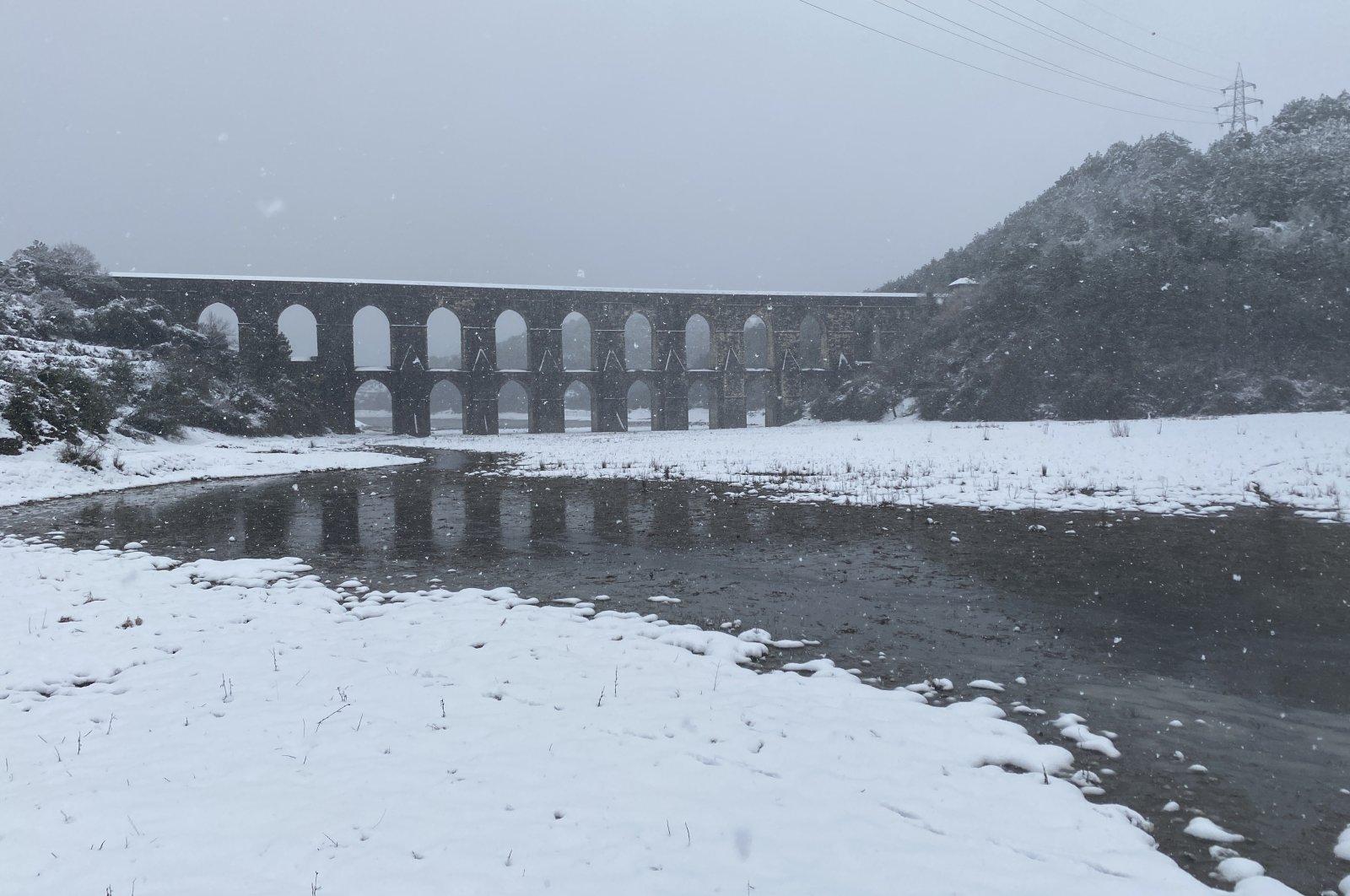 A view of Alibeyköy Dam during snowfall, in Istanbul, Turkey, Feb. 15, 2021. (IHA Photo)
