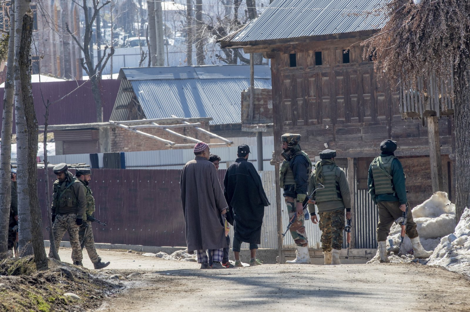 Paramilitary soldiers question Kashmiri villagers during a search operation in Beerwah area, Indian controlled Kashmir, Feb. 19, 2021. (AP Photo)