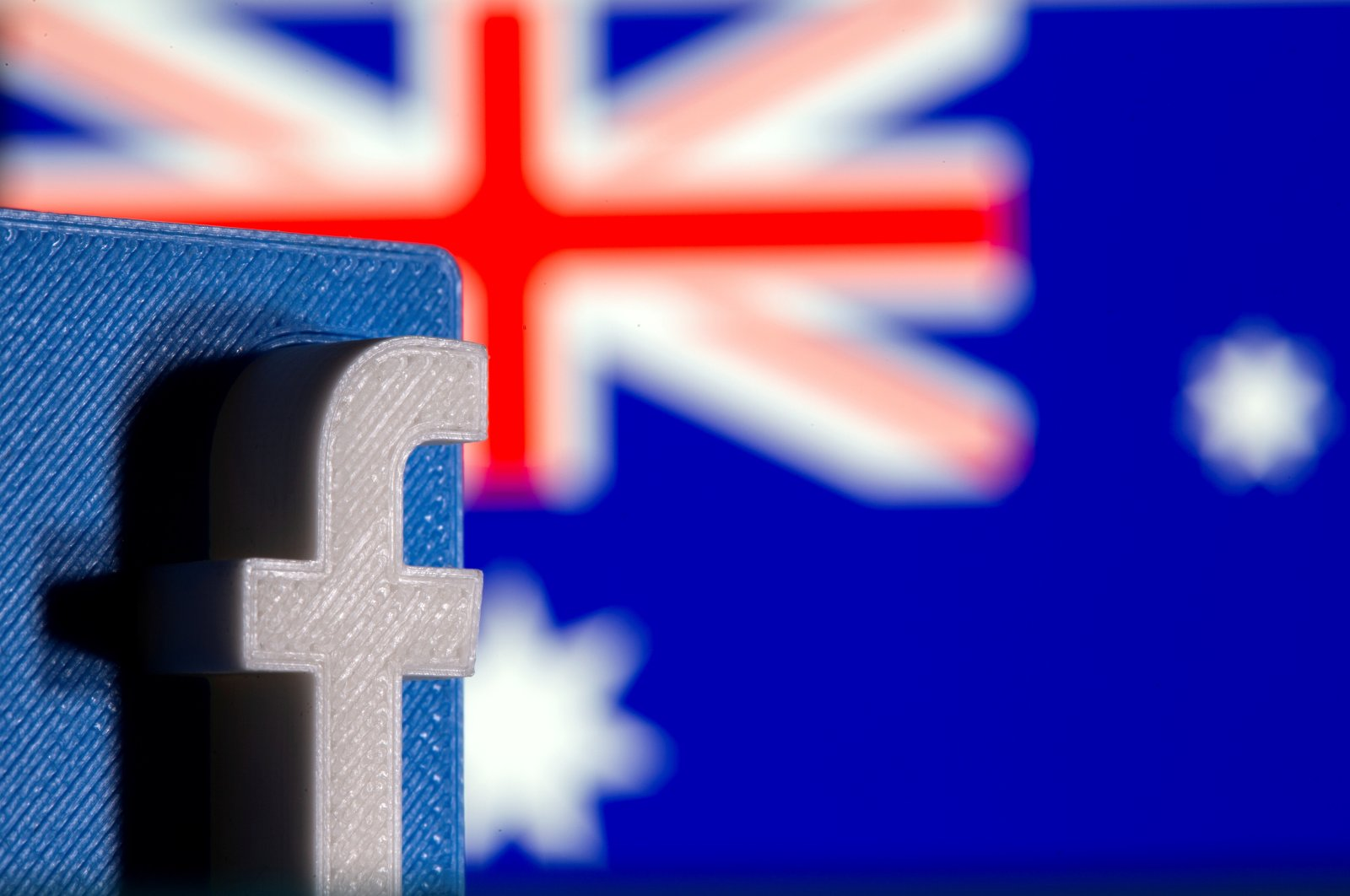 A 3D printed Facebook logo is seen in front of the displayed Australia's flag in this illustration photo taken Feb. 18, 2021. (Reuters Photo)