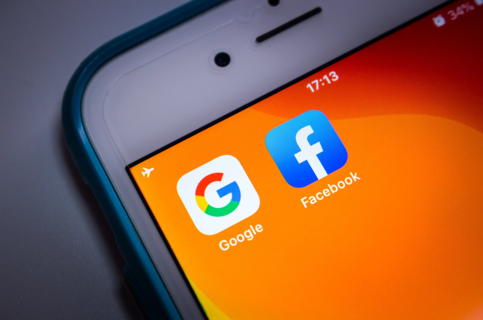 The icons of Google and Facebook icons are seen on the screen of an iPhone in this file photo taken in Kumamoto, Japan, May 21, 2020. (Shutterstock Photo)