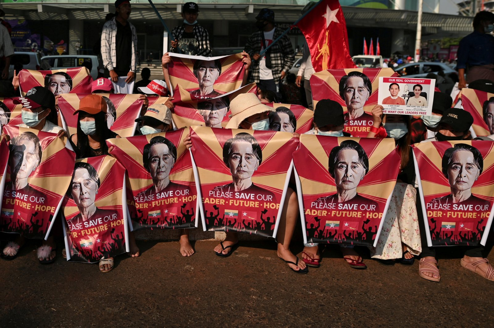 People take part in a protest against the military coup in Yangon, Myanmar, Feb. 20, 2021. (Reuters Photo)