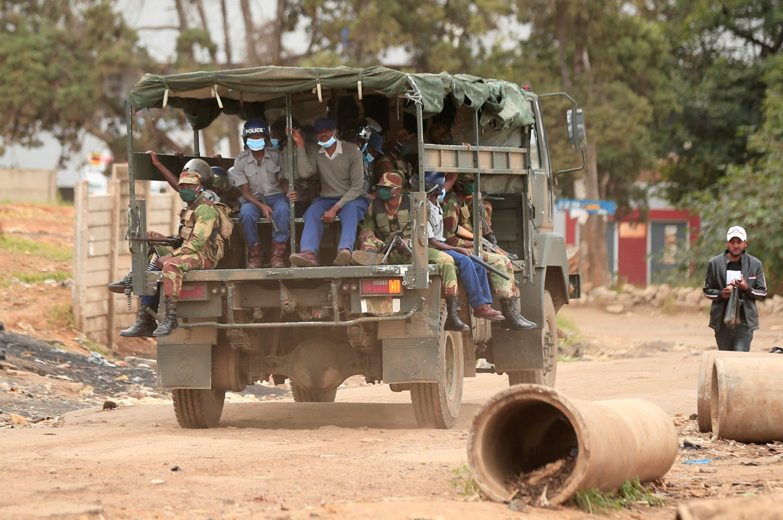 Police and soldiers patrol the streets during a nationwide lockdown called to help curb the spread of coronavirus disease in Harare, Zimbabwe, April 19, 2020. (Reuters Photo)