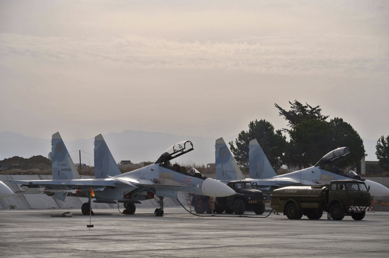 Russian fighter jets are parked in preparation for combat action at Hemeimeem air base, Syria, Oct. 22, 2015. (AP Photo)