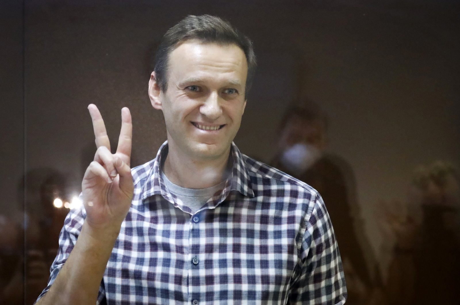 Russian opposition leader Alexei Navalny stands in a cage in the Babuskinsky District Court in Moscow, Russia, Feb. 20, 2021. (AP Photo)