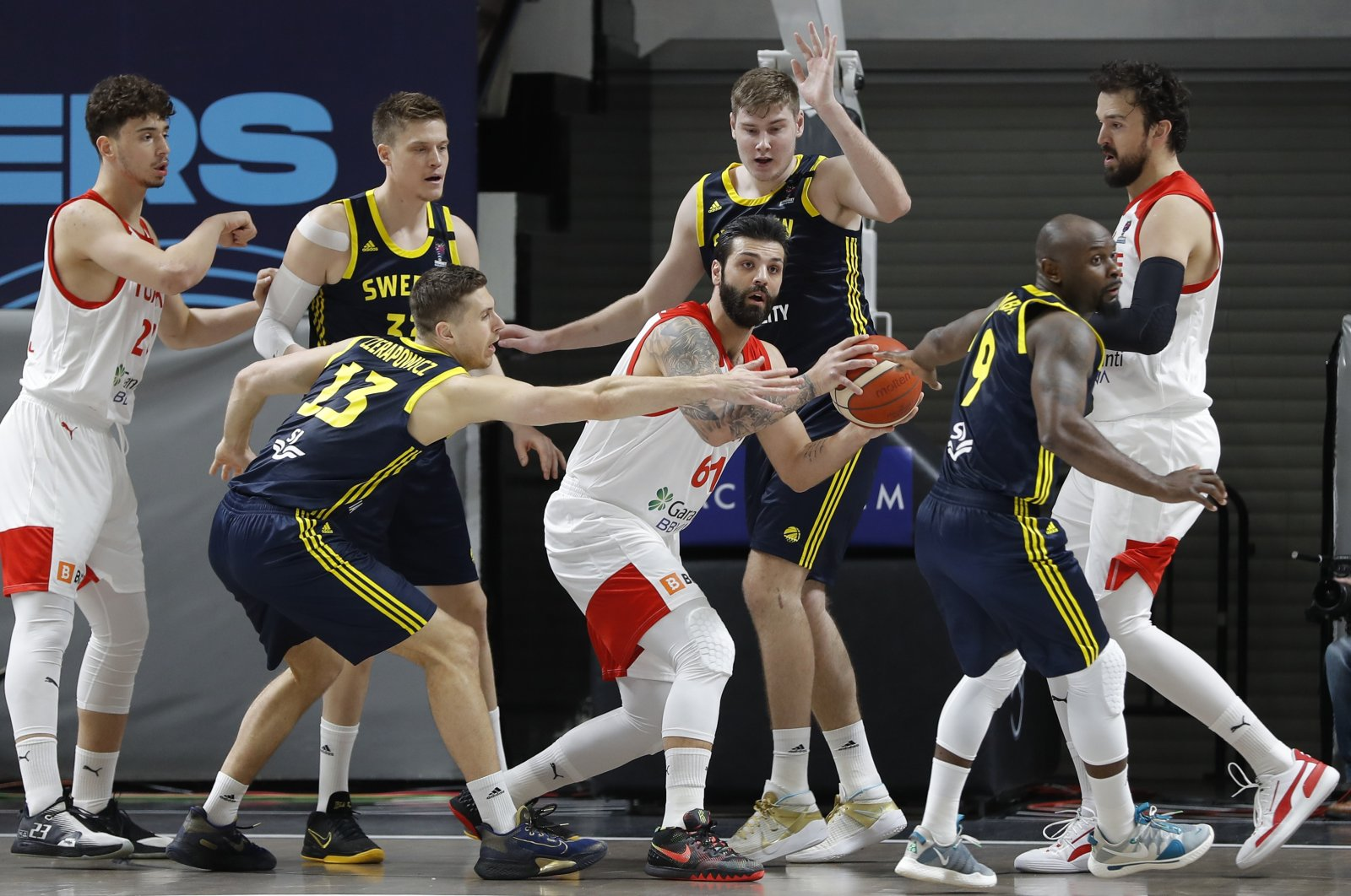 Turkey's and Sweden's players fight during a EuroBasket 2022 Group D qualifier basketball match between Turkey and Sweden, in Istanbul, Feb. 20, 2021. (AP Photo)