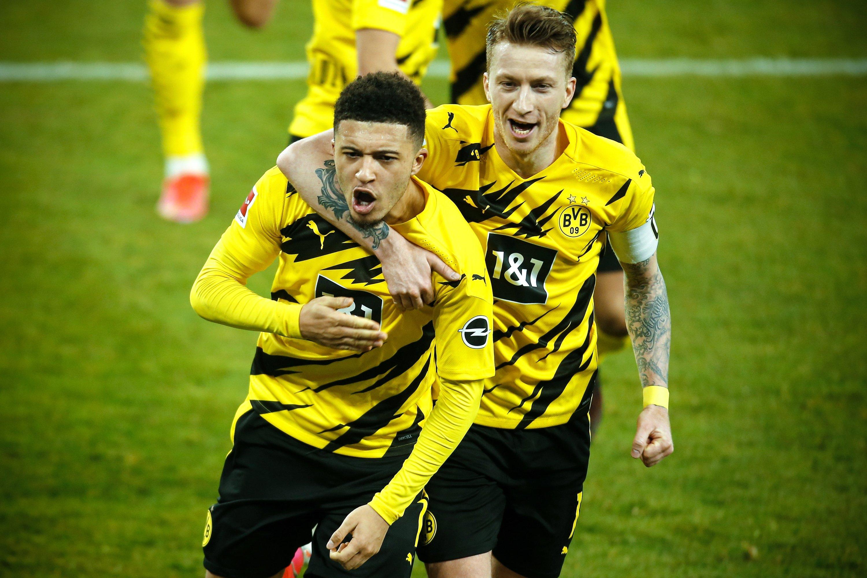 Dortmund's Jadon Sancho (L) celebrates with his teammate Marco Reus (R) after scoring first goal against Schalke in Gelsenkirchen, Germany, Feb. 20, 2021. (EPA Photo)