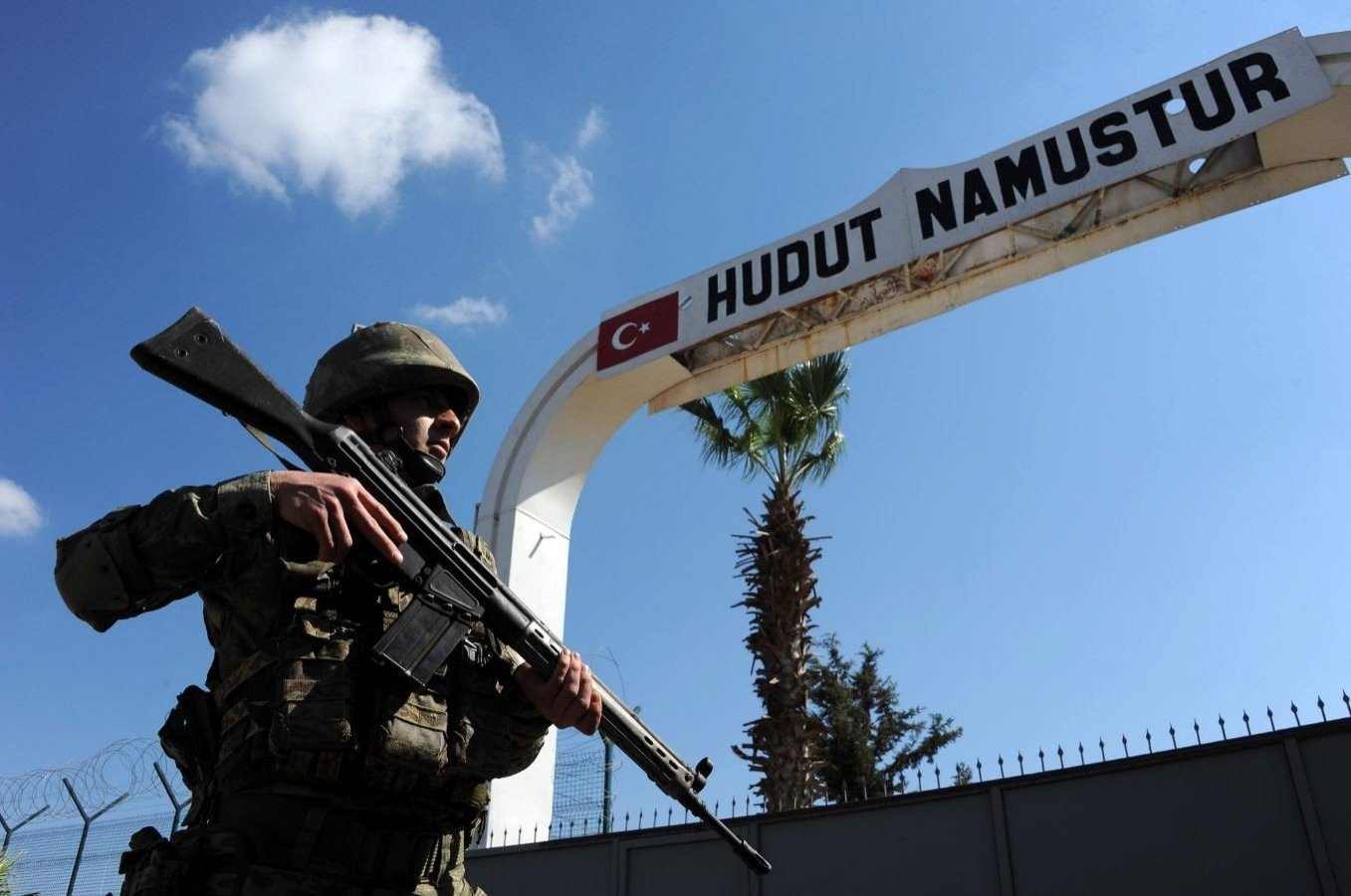 A border guard is seen keeping watch at the border in Turkey's southern Hatay province, Feb. 15, 2021. (IHA Photo)
