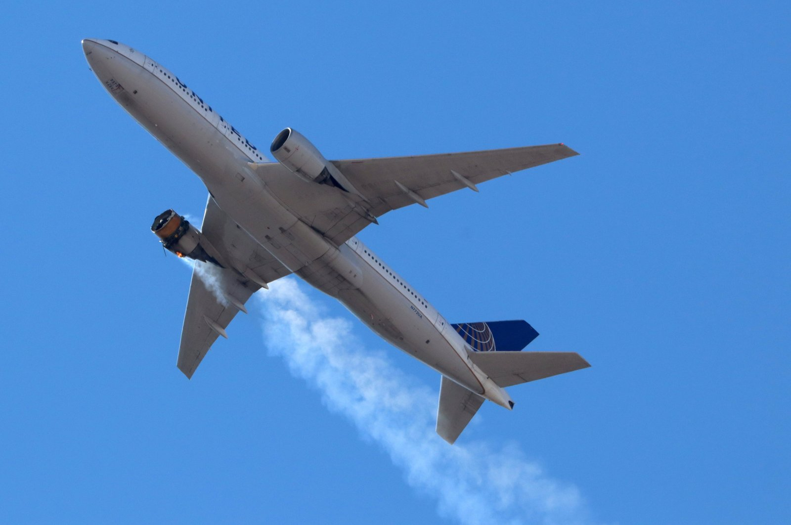 United Airlines flight UA328, carrying 231 passengers and 10 crew on board, returns to Denver International Airport with its starboard engine on fire after it sent a Mayday alert, over Denver, Colorado, U.S., Feb. 20, 2021. (Reuters Photo)