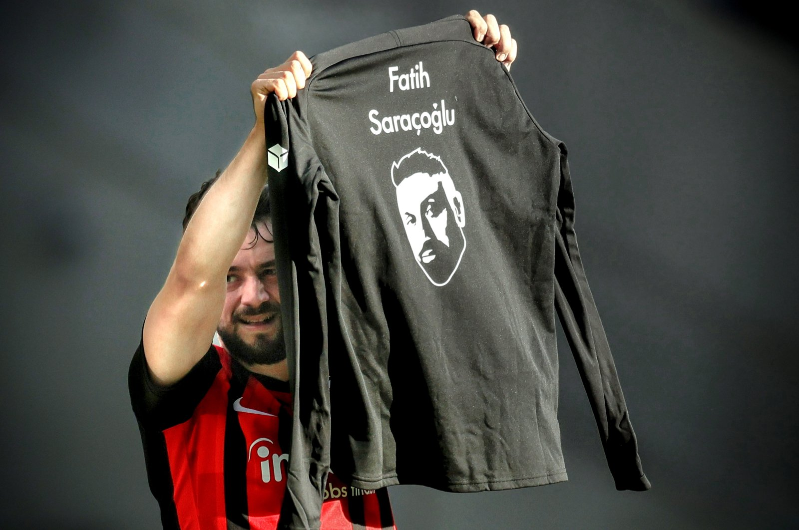 Frankfurt's Amin Younes shows a jersey with the portrait of one of the victims of the Hanau shooting attack on Feb. 19, 2020, celebrating his goal against Bayern Munich, Frankfurt, Germany, Feb. 20, 2021. (EPA Photo)