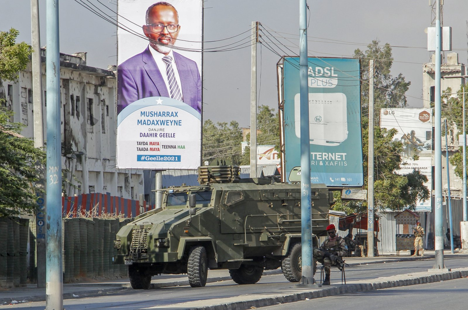 Security forces block a street with an armored personnel carrier during protests against the government and the delay of the country's election in the capital Mogadishu, Somalia, Feb. 19, 2021. (AP Photo)