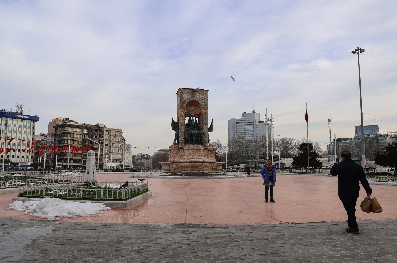The famous Taksim Square, normally bustling with people, is nearly empty due to COVID-19 restrictions in Istanbul, Turkey, Feb. 20, 2021. (AA Photo)