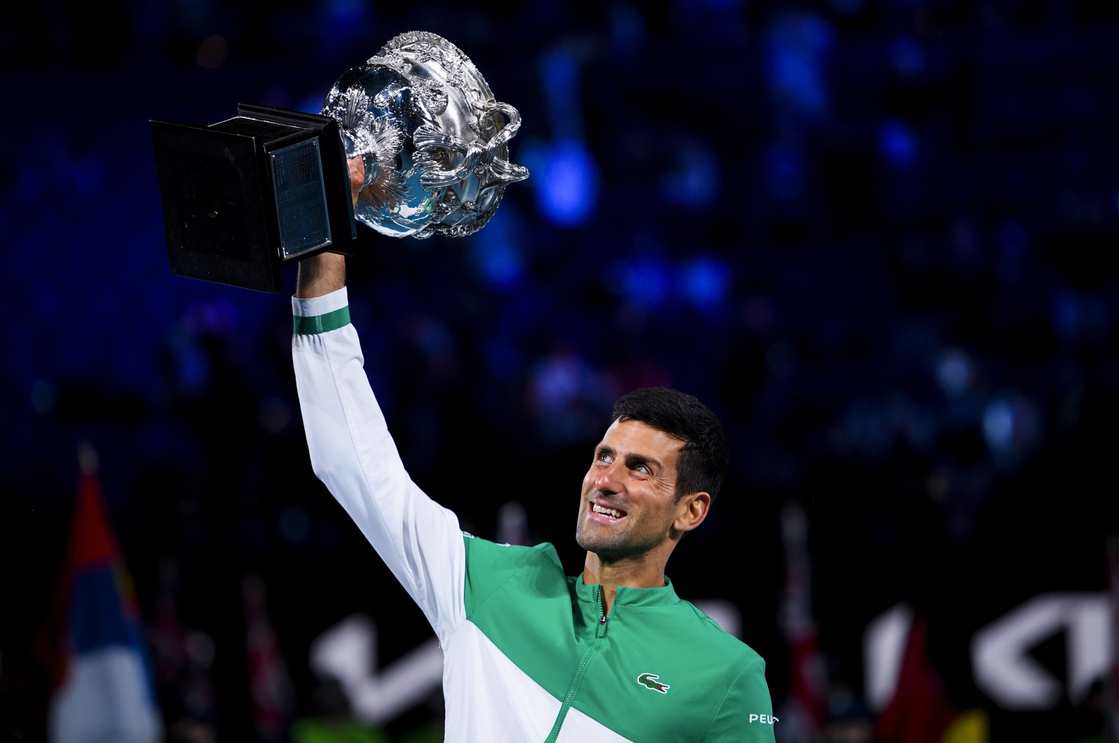 Serbia's Novak Djokovic lifts the trophy after winning the Australian Open men's singles finals against Russia's Daniil Medvedev at Melbourne Park, Melbourne, Australia, Feb. 21, 2021.  (EPA Photo)