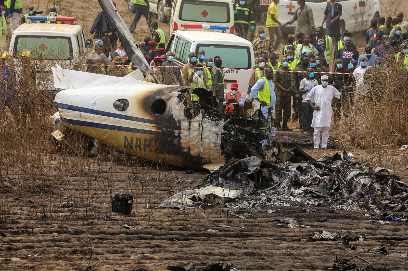 Rescuers and people gather near the debris of a Nigerian air force plane, which according to the aviation minister crashed while approaching the Abuja airport runway, in Abuja, Nigeria, Feb. 21, 2021. (Reuters Photo)