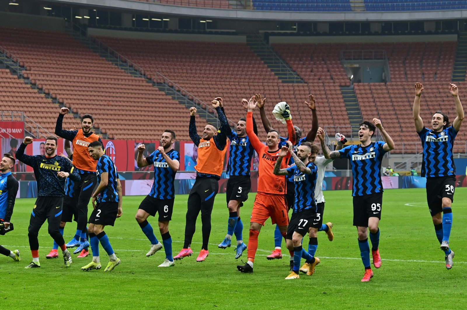 Inter players celebrate winning at the end of the Italian Serie A football match AC Milan vs Inter Milan at the San Siro stadium in Milan, Feb. 21, 2021. (AFP Photo)
