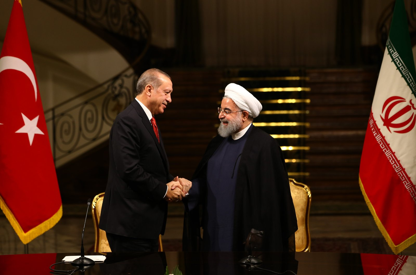 President Resep Tayyip Erdoğan (L) and Iranian President Hassan Rouhani (R). (AA File Photo)