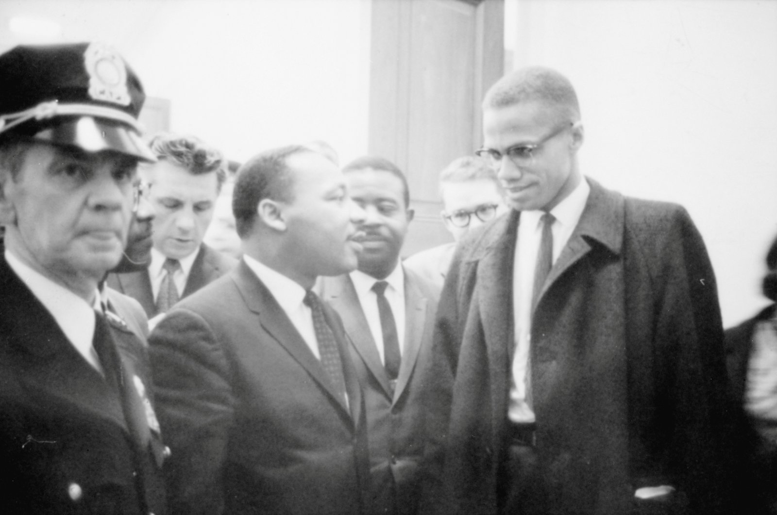 Martin Luther King Jr. and Malcolm X wait for a press conference to begin in an unknown location, March 26, 1964. (Library of Congress/Marion S. Trikosko/Handout via Reuters)