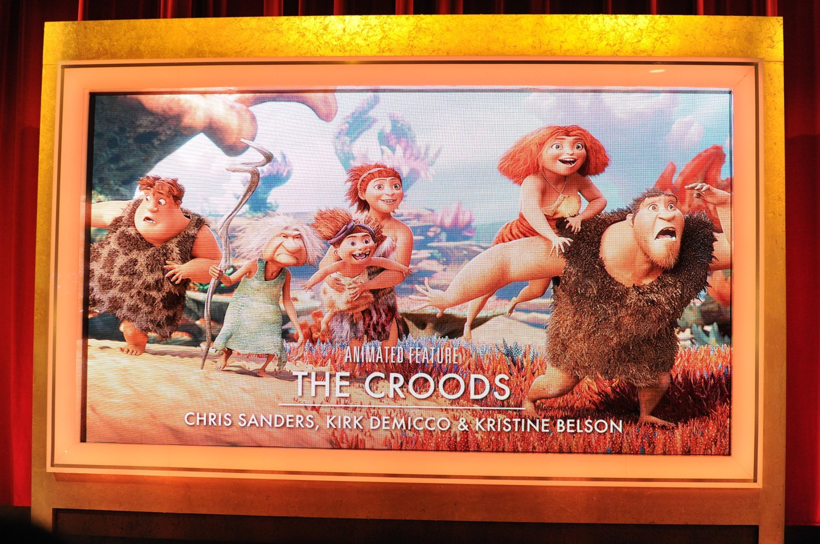 """A giant screen shows """"The Croods"""" as the Oscar nominee for Best Animated Feature at the 86th Academy Awards Nominations Announcement at AMPAS Samuel Goldwyn Theater on Jan. 16, 2014 in Beverly Hills, California.  (Photo by Allen Berezovsky/WireImage via Getty)"""