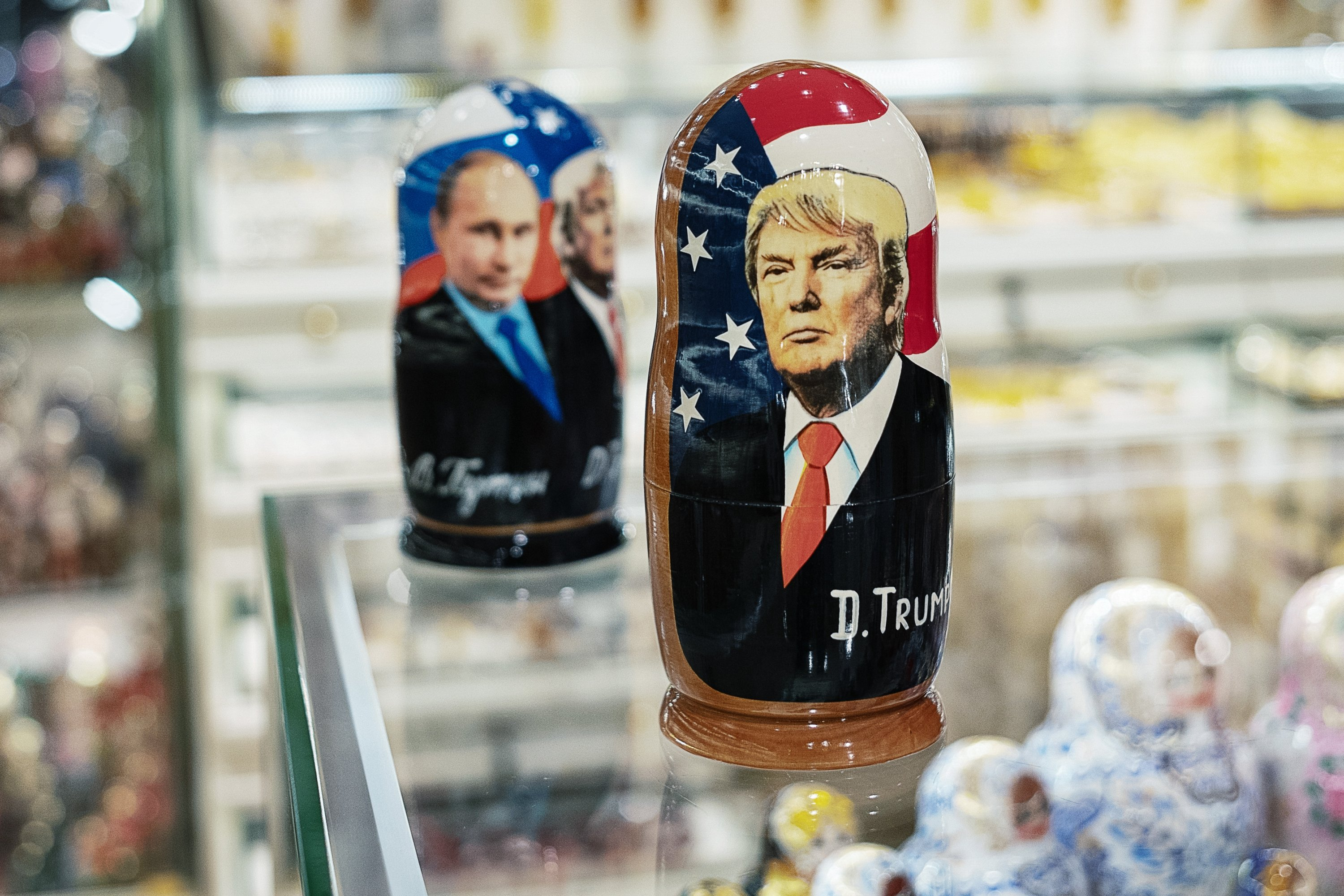 A souvenir shopkeeper displays Matryoshka dolls featuring Russian President Vladimir Putin (L) and then-U.S. President Donald Trump, Moscow, Russia, Dec. 3, 2019. (Photo by Getty Images)