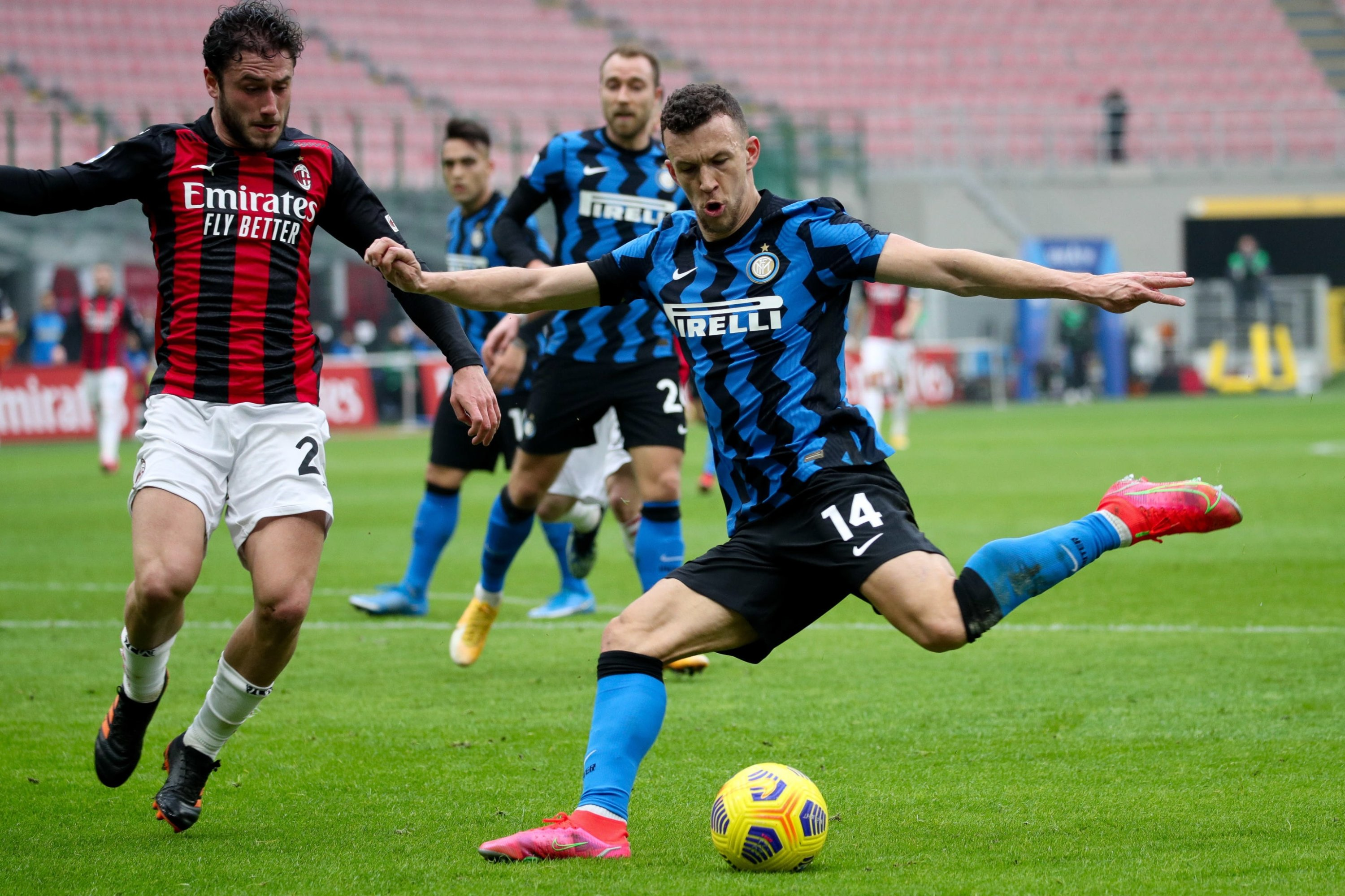 Inter midfielder Ivan Perisic (R) and AC Milan defender Davide Calabria during a match at the Giuseppe Meazza Stadium, Milan, Italy, Feb. 21. 2021. (EPA Photo)