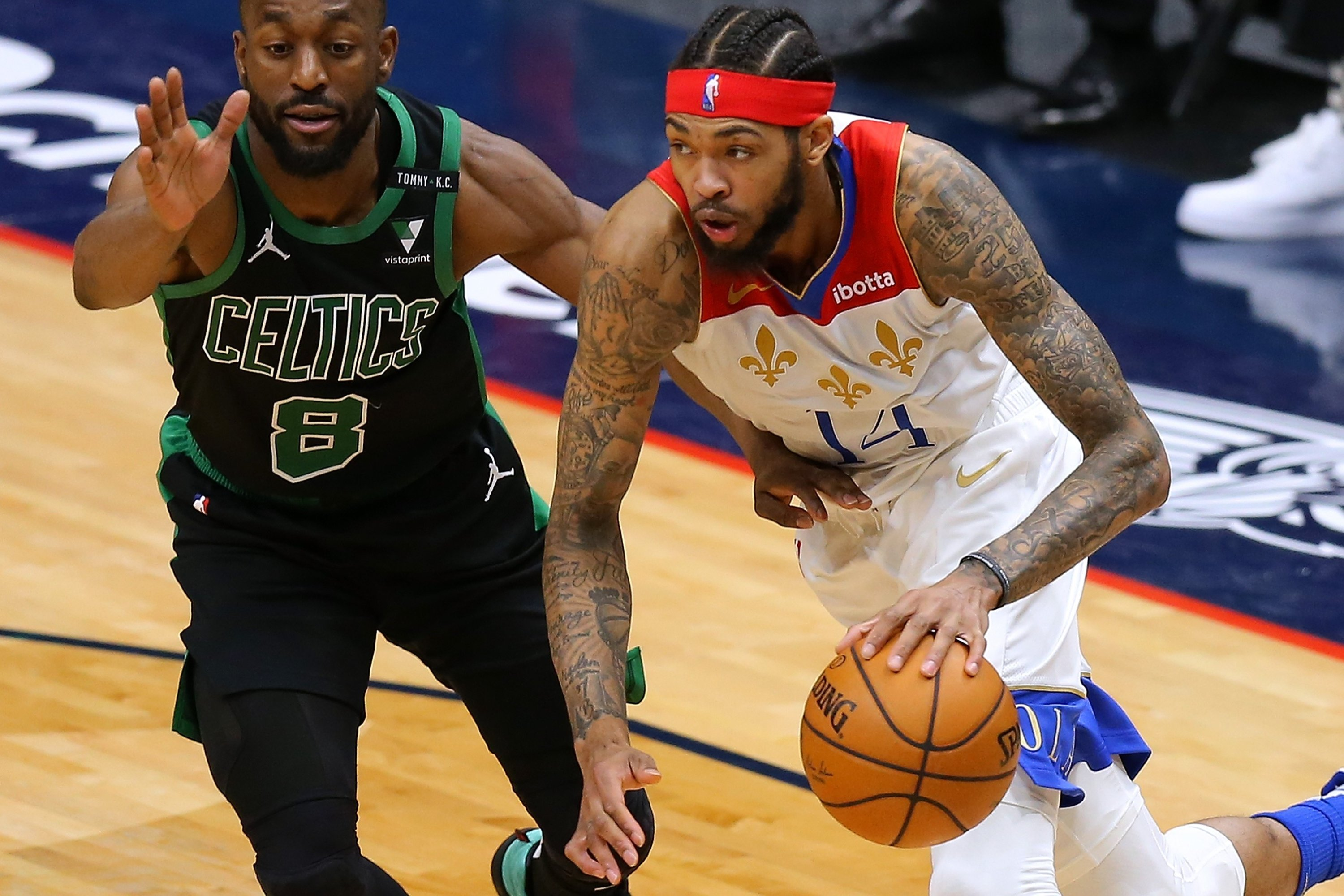 New Orleans Pelicans' Brandon Ingram (R) drives against Boston Celtics' Kemba Walker (L) during an NBA match at at the Smoothie King Center, New Orleans, Louisiana,Feb. 21, 2021. (AFP Photo)