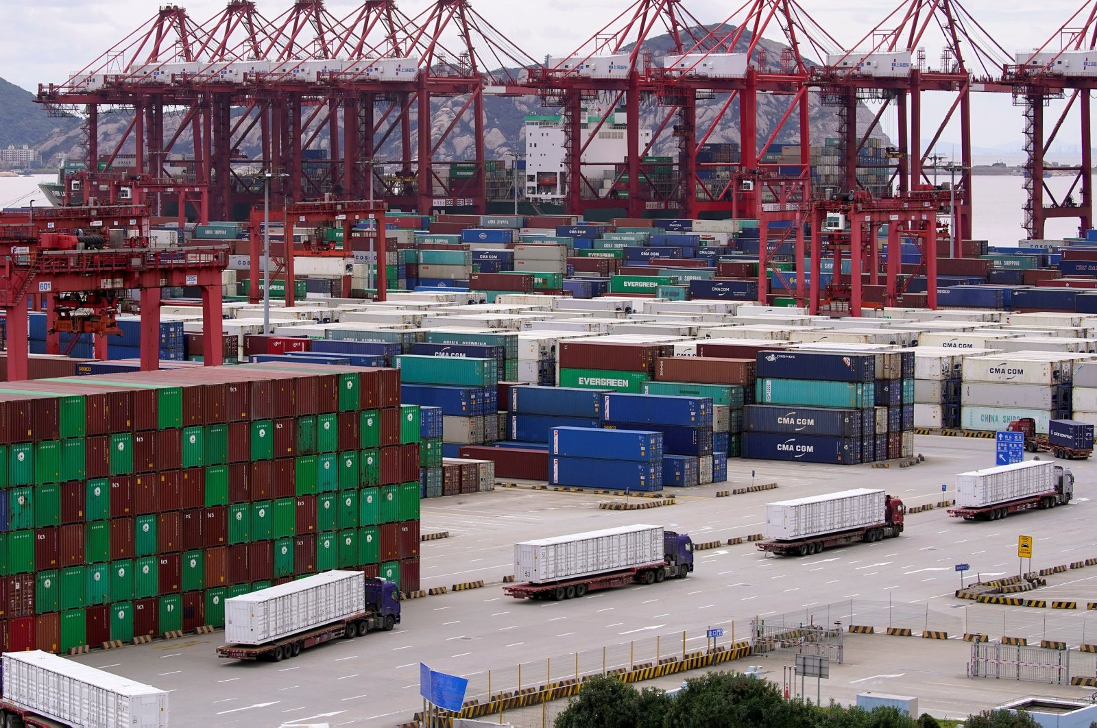 Containers and trucks are seen at the Yangshan Deep Water Port in Shanghai, China, as the pandemic continues, Oct. 19, 2020. (Reuters Photo)