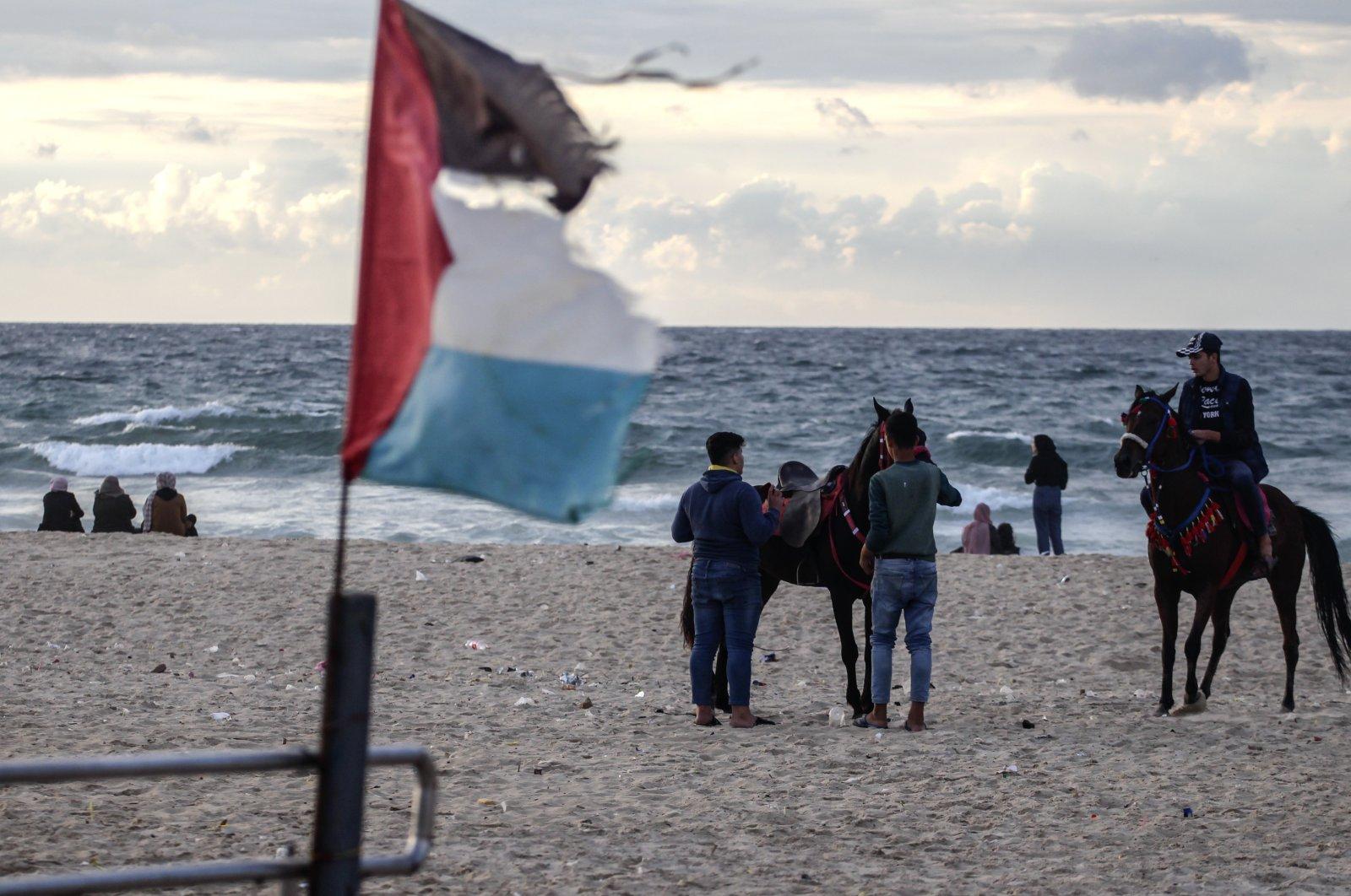 Palestinians enjoy Gaza Beach during sunset, Gaza Strip, Palestine, Nov. 25, 2020. (Photo by Getty Images)