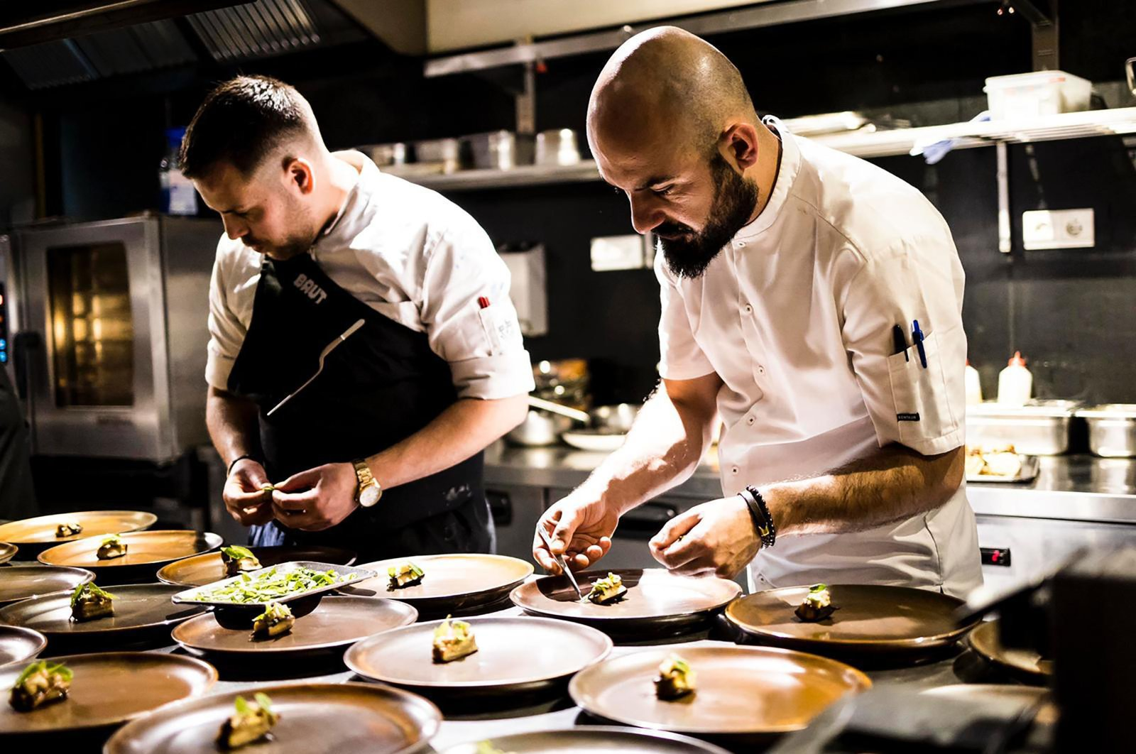 Michelin-starred Chef Ahmet Dede prepares food alongside another chef. (Archive Photo)